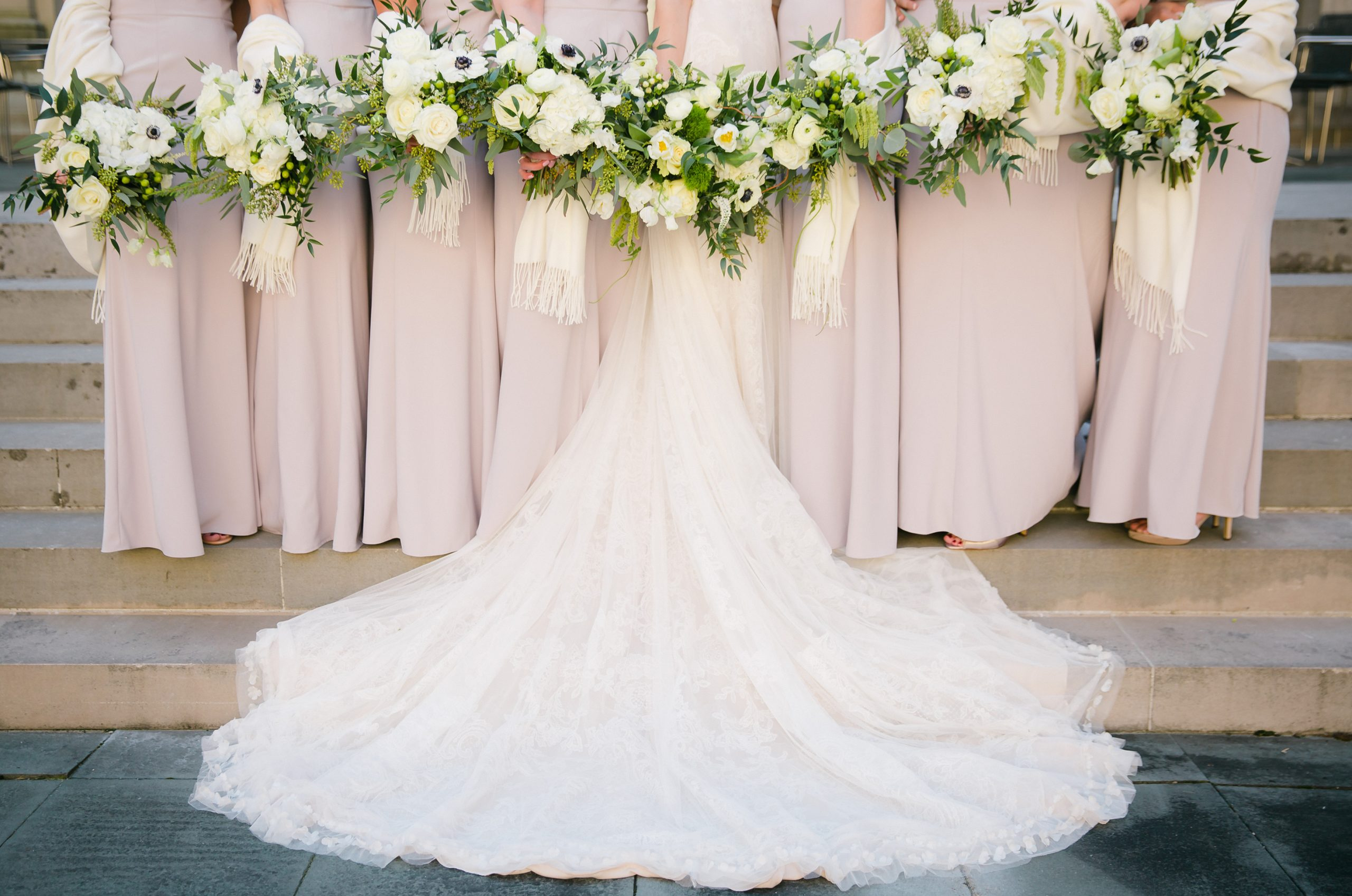 Bridal party blush pink dresses with white an green fresh spring wedding bouquets